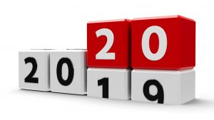 White cubes with 2019-2020 change on a white table represents the new 2020 year,